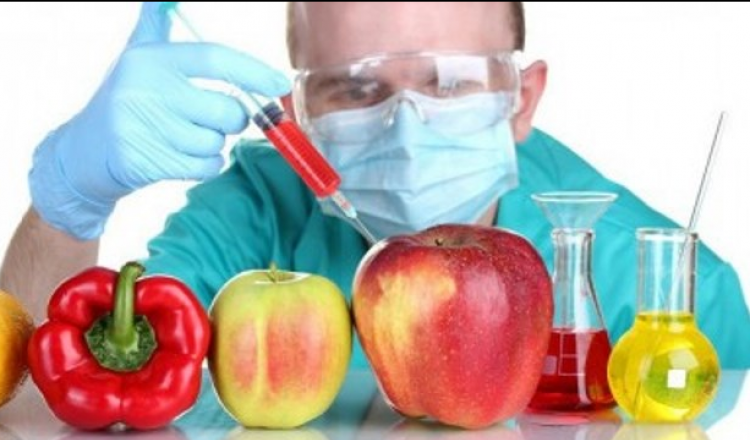 An Image showing a scientist going to inject chemicals into the vegetables